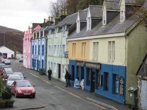 Colorful buildings near the water's edge; Portree, The Isle of Skye