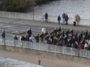 A parade marches across the bridge at Inverness to commemorate fallen soldiers