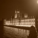 girls peering at parliament (black & white)