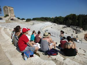 A student presentation on Greek drama in the ancient Greek Theater of Syracuse