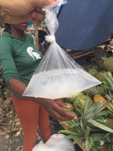 I wanted to eat what was in the coconut so the vendor poured the water in and scraped on the inside of the coconut into the bag.
